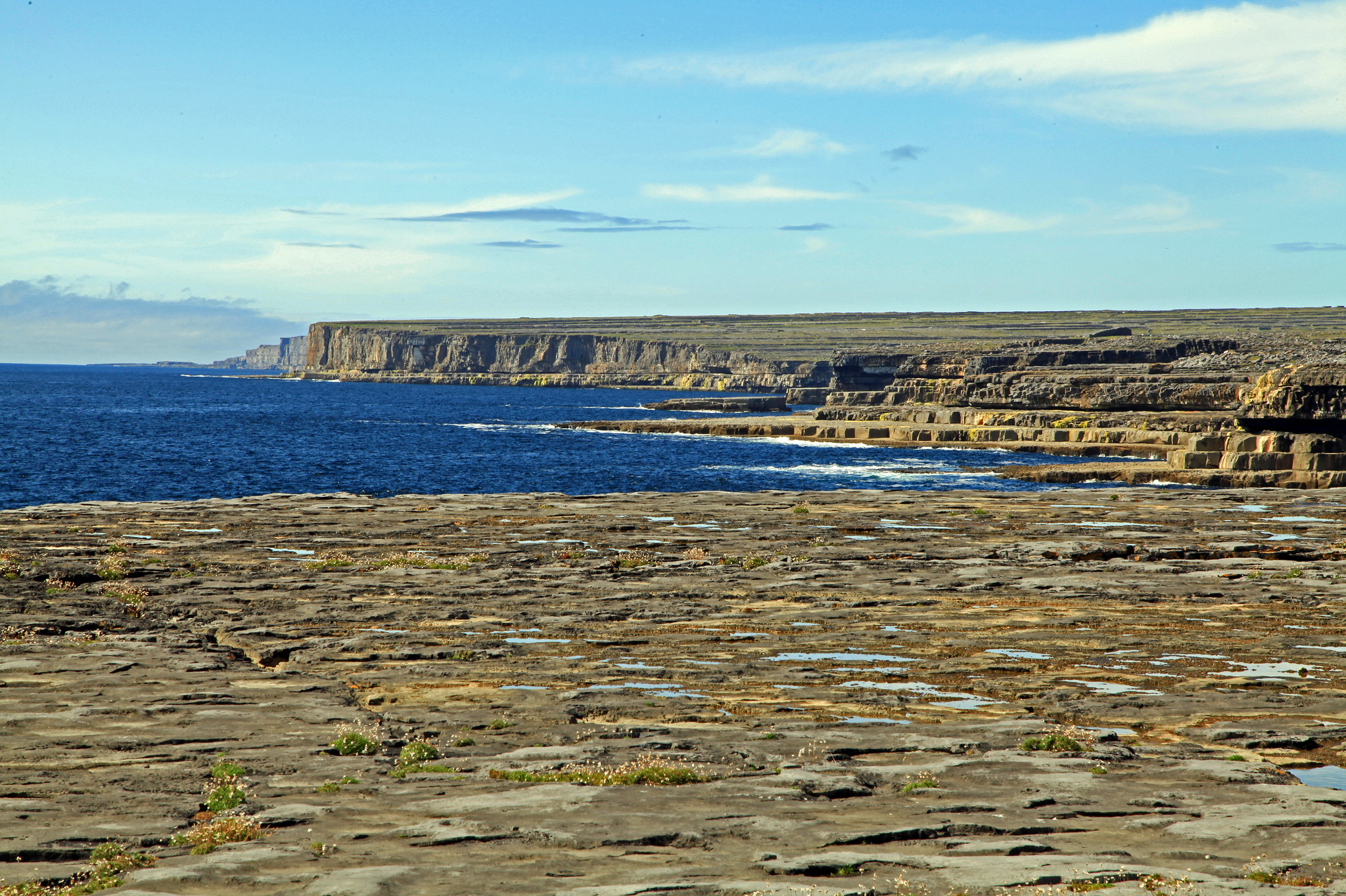 The very edge of the Burren, forming a huge, sheer cliffline as it dives into the Atlantic ocean.